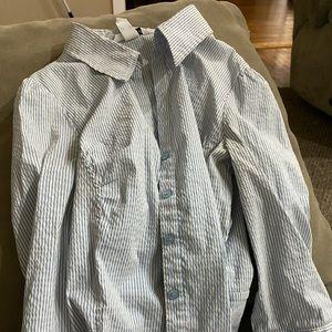 Women's blue striped button down shirt
